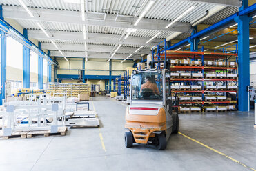 Man on forklift in factory warehouse - DIGF03163