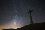 Italy, Marche, silhouette of summit cross on Monte Catria at night - LOMF00663
