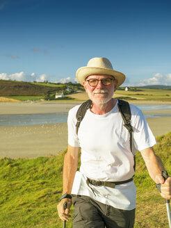France, Bretagne, Active senior hiking on the beach of Treguer - LAF01935
