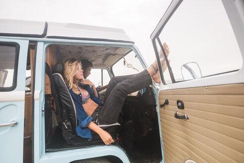 Young couple having a break inside van - SIPF01845