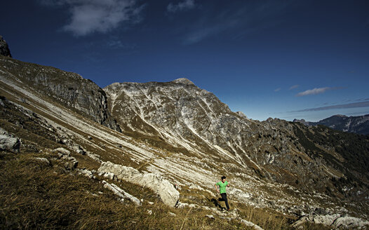 Germany, Allgaeu Alps, man running in mountains - MALF00010