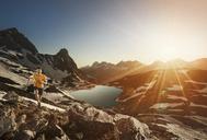 Germany, Allgaeu Alps, man running in mountains - MALF00013