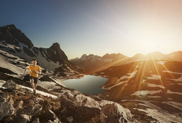 Germany, Allgaeu Alps, man running in mountains - MALF00013