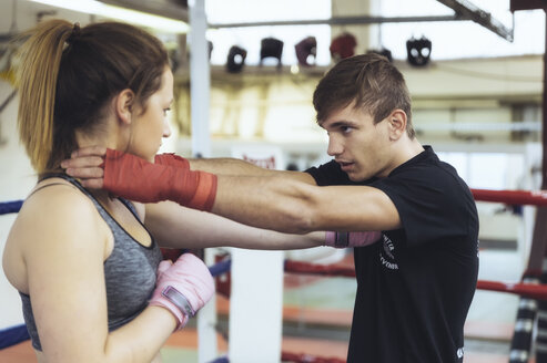 Female martial artist sparring with coach - FRF00605