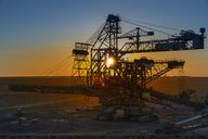 Germany, North Rhine-Westphalia, Juechen, Garzweiler surface mine, Stacker at sunset - FRF00613