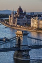 Hungary, Budapest, Chain Bridge on Danube river and Hungarian Parliament at sunset - ABOF00316