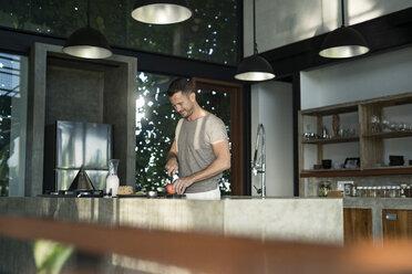 Mature man standing in kitchen, preparing healthy breakfast - SBOF00883