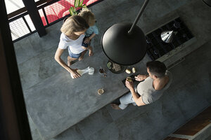Family preparing healthy breakfast in comfortable kitchen - SBOF00889