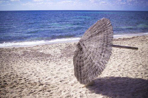Spain, Formentera, removal of beach umbrellas, end of season - CMF00733