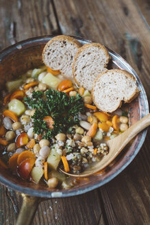 Mediterranean soup and bread slices in copper pot - GIOF03289