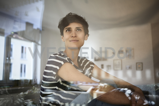 Portrait of woman at home thinking - RBF06113