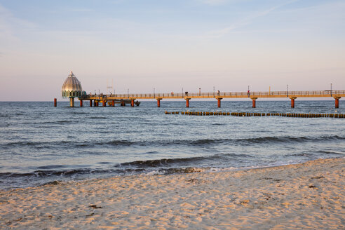 Germany, Zingst, view to submarine gondola and boardwalk at twilight - WIF03457
