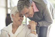 Happy affectionate senior couple together at home - ZEF14765