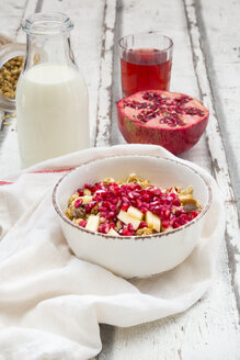 Breakfast with fruit muesli with pomegranate seed, bottle of milk and glass of pomegranate juice - LVF06413