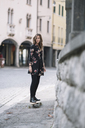 Portrait of fashionable woman on skateboard - ALBF00224