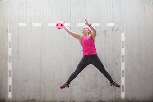 Woman jumping to catch a ball - ZEF14830