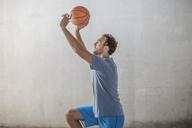 Sportive man throwing a basketball - ZEF14842