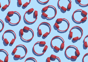 Collection of red wireless headphones on light blue background, 3D Rendering - DRBF00035