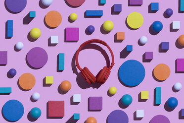 Red wireless headphones surrounded by geometric shapes, 3D Rendering - DRBF00041