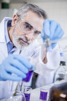 Scientist in lab working with liquid - WESTF23745