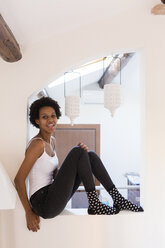 Portrait of happy young woman at home - GIOF03440