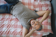 Relaxed mature man lying on bed - ALBF00274