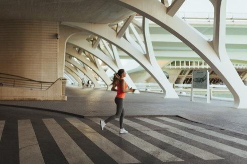 Spain, Valencia, woman running at Ciudad de las Artes y de Las Ciencias - JPF00295