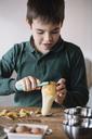 Boy peeling a pear - ALBF00293