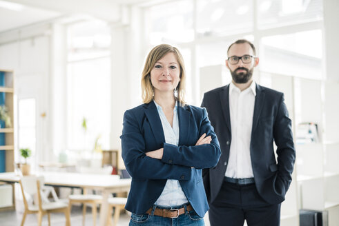 Portrait of confident businesswoman and man in office - JOSF01909