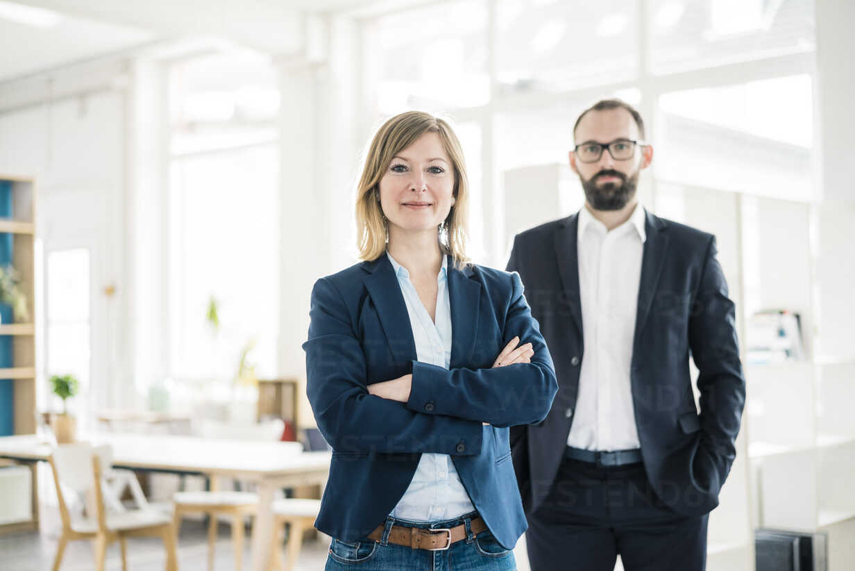 Portrait of confident businesswoman and man in office - JOSF01909 - Joseffson/Westend61