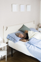 Young woman sleeping in bed - GIOF03469