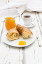 Croissant breakfast, apricot jam and cup of coffee - LVF06425