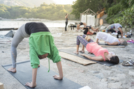 Mexico, Mismaloya, yoga class at ocean front - ABAF02185