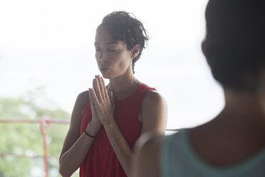 Woman doing a yoga exercise - ABAF02191