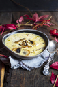 Bowl of cheese soup with leek and mushrooms - SBDF03378