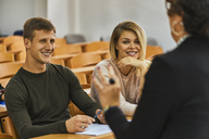 Smiling students and lecturer in auditorium at university - ZEDF01007