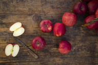 Red apples and knife on wood - LVF06429