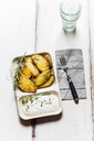 Bowl of potato wedges with rosemary and herbed curd cheese - SBDF03391