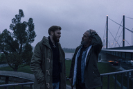 Father and son meeting on bridge, discussing business - KNSF02875