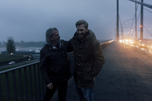 Father and son meeting on bridge, discussing business - KNSF02920