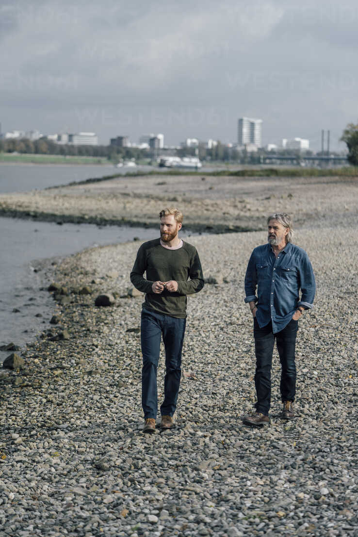 Father and son taking a stroll at Rhine river, meeting to talk - KNSF02932 - Kniel Synnatzschke/Westend61