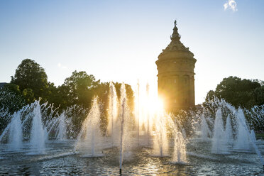 Germany, Baden-Wuerttemberg, Mannheim, Water Tower and fountain at sunset - PUF00940