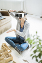 Woman in office with architectural model wearing VR glasses - JOSF01959