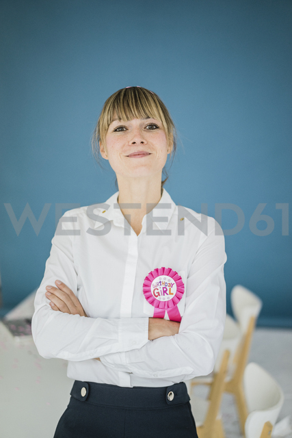 Portrait of smiling businesswoman in office celebrating her birthday - JOSF01962