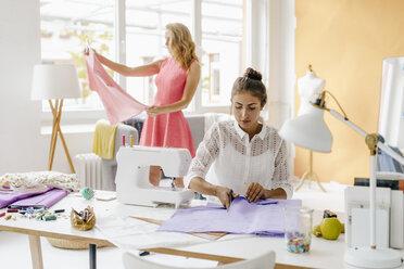 Two young women in fashion studio - KNSF02963