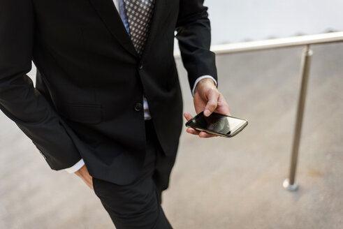 Close-up of businessman using smartphone outdoors - VABF01382