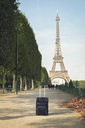 France, Paris, Champ de Mars, view to Eiffel Tower with trolley bag in the foreground - CHPF00450