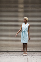USA, New York, young blonde african-american woman looking sideways - MAUF01246