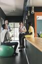 Business people having an informal meeting in office - UUF12411