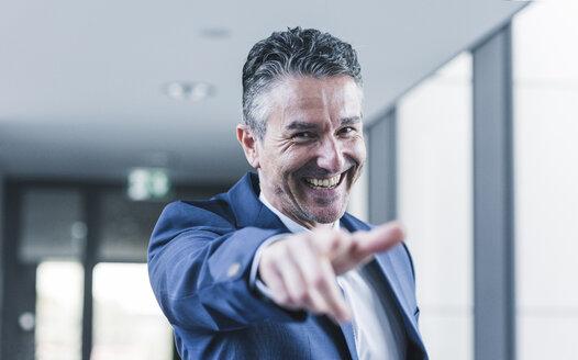 Portrait of happy businessman - UUF12432